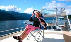 A pensioner enjoys the sunshine on a cruise ship.