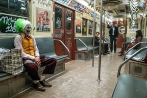 Grit … Joaquin Phoenix as Joker on the subway.