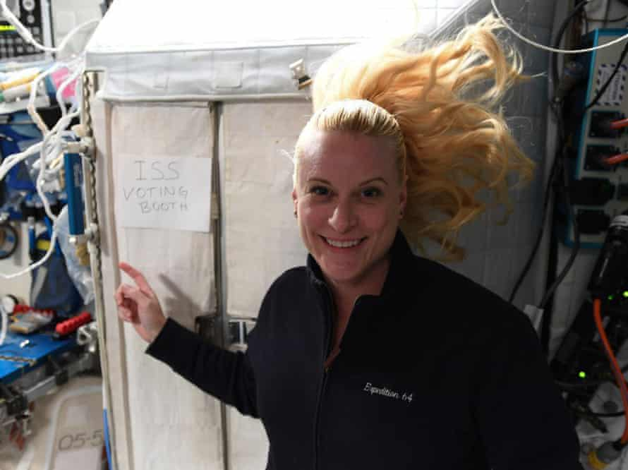 woman in zero gravity with blond pony tail flying up behind her head