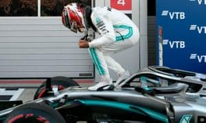 Lewis Hamilton celebrates.