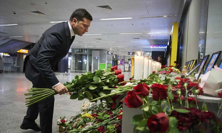 The Ukrainian president, Volodymy Zelenskiy, pictured laying flowers for the victims of the plane crash, called for 'assurances of readiness for full and open investigation' from Iran.