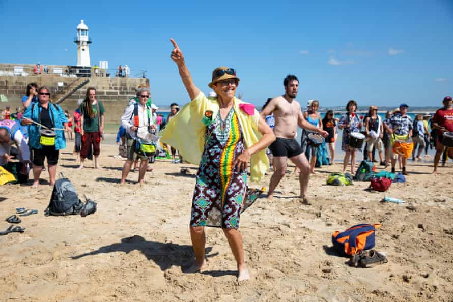 Extinction Rebellion protesters at a 'discobedience' event on the beach in St Ives