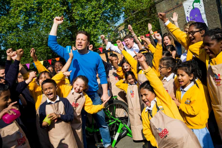 On the campaign trail … Oliver with children from St Paul's Whitechapel primary school in east London for Food Revolution Day in 2014.