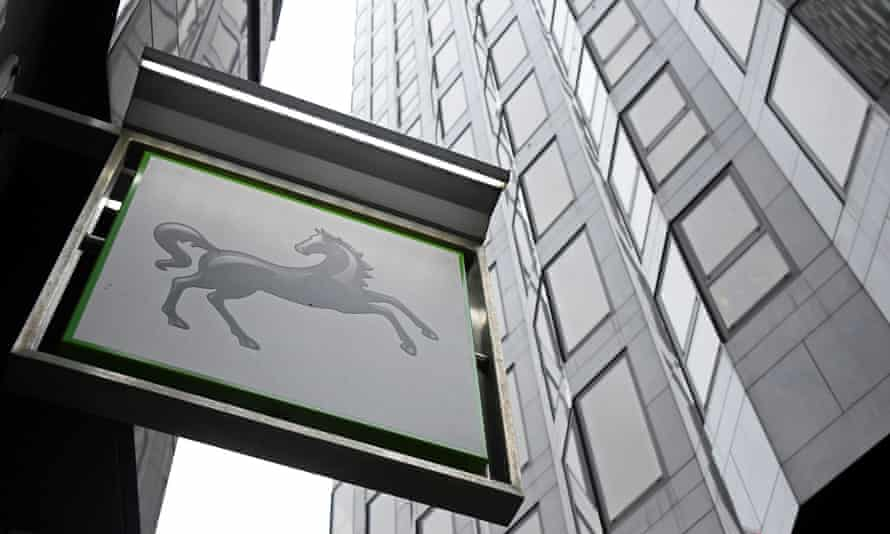 A sign hangs outside a Lloyds Bank branch in London