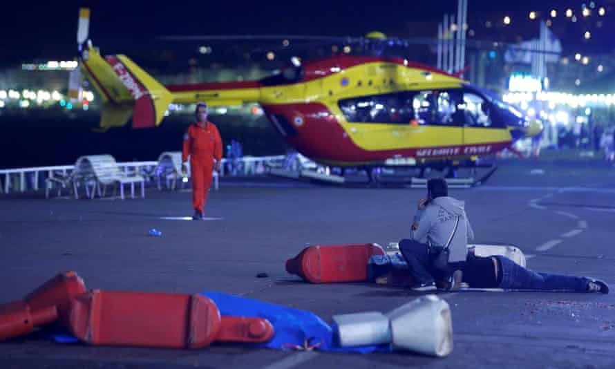 An injured individual on the ground after the attack in Nice