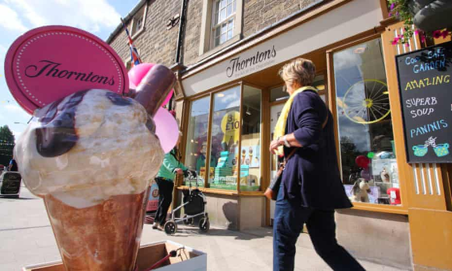 A woman walks by a Thorntons chocolate shop in Bakewell, Derbyshire