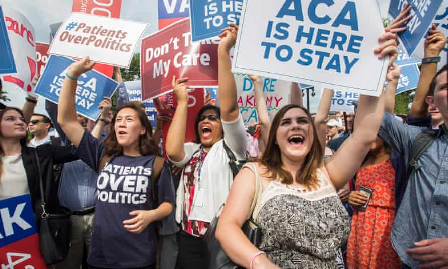 Demonstrators hold signs supporting the Affordable Care Act, commonly known as Obamacare.