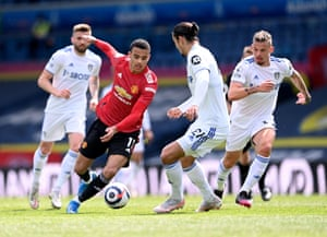 Greenwood makes his way through a crowded Leeds midfield