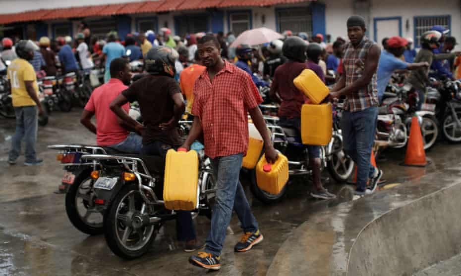 Men carry fuel containers in the capital, Port-au-Prince.