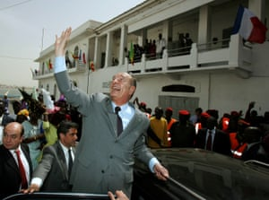 Chirac waves as he leaves Saint-Louis during a visit to Senegal in February 2005