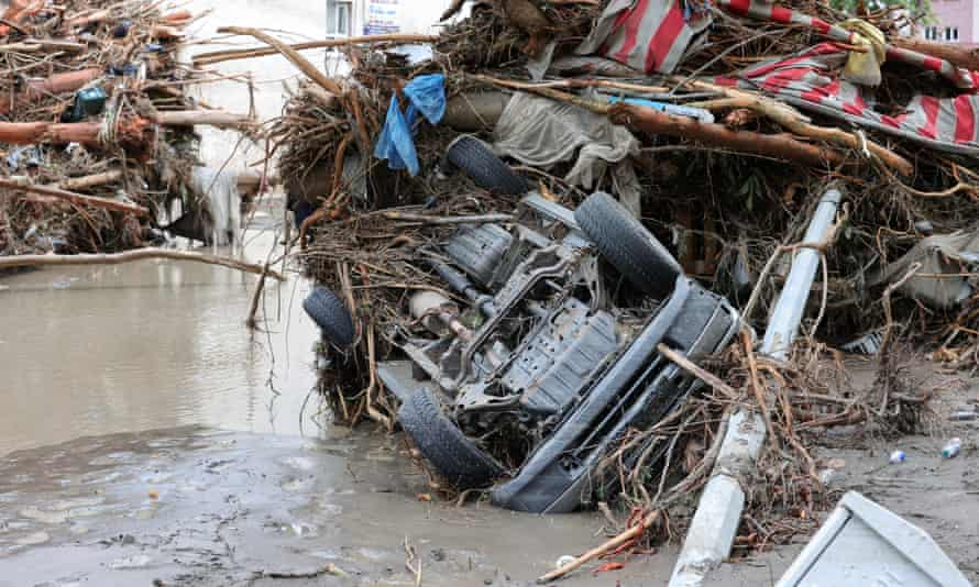 A car left wrecked after heavy rains cause floods in Kastamonu.