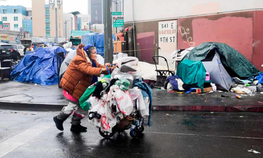 skid row tents, woman pushes cart