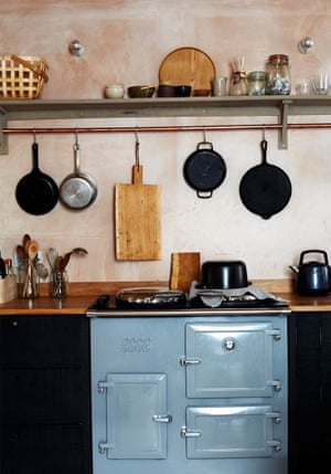 The food photographer's traditional setting includes a rustic skimmed plaster wall and duck-egg blue, old-school cooker. @kristinperers