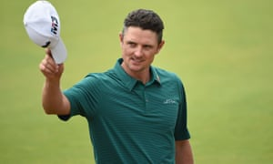 England's Justin Rose acknowledges the applause after holing his birdie putt on the 18th green
