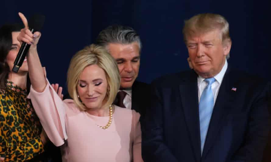 Paula White prays with Donald Trump.