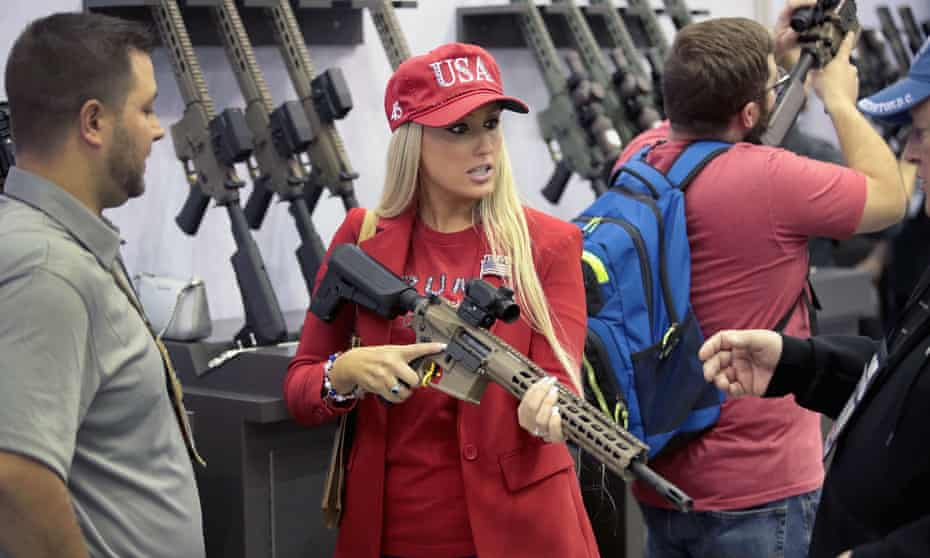 A woman wears a Trump hat at a booth at the NRA's annual convention in Indianapolis, Indiana, on 27 April.