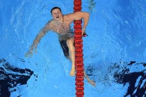 Britain's Adam Peaty celebrates after he broke the world record in the men's 100m breaststroke final.