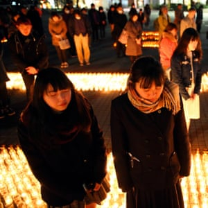 People offer prayer with candle-hit lanterns in Nagoya, Aichi