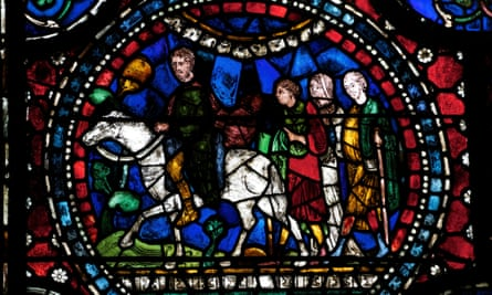 Pilgrims depicted in the stained-glass windows of Canterbury Cathedral.