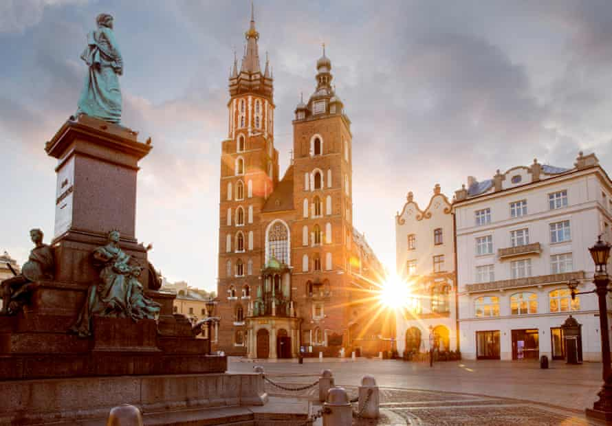 Adam Mickiewicz monument and St Mary's Basilica in Krakow, Poland