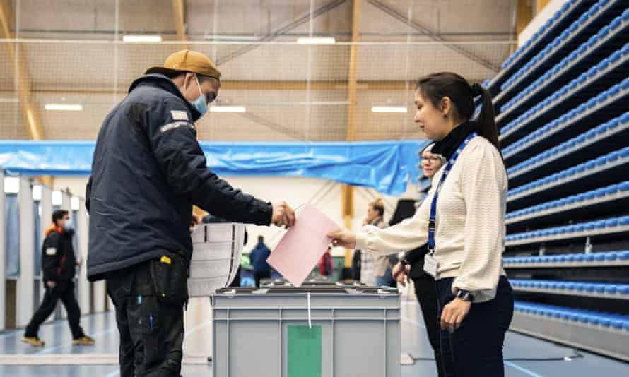 A man casts his ballot in the parliamentary election in Greenland's capital, Nuuk, on Tuesday, with the opposition IA party leading in the polls.