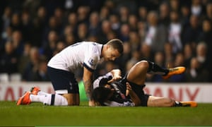 Jose Manuel Jurado of Watford lies injured after colliding with Kieran Trippier.