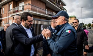 Matteo Salvini, left, is greeted by residents in Rome