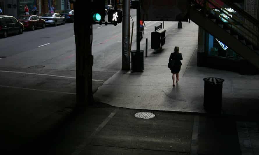 Woman walks alone at night