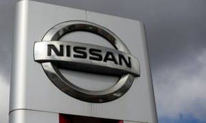 A sign for a Nissan car dealership.
