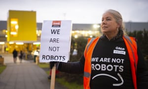 A GMB union member protests for better workplace conditions at Amazon in Swansea last month.
