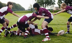 Schoolboys playing rugby.