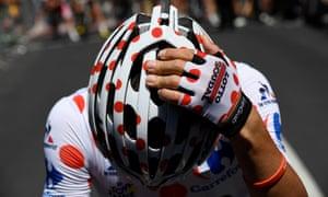 Belgium's Thomas De Gendt adjusts his helmet