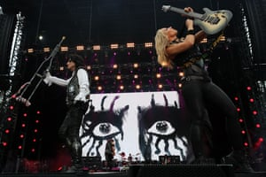 Alice Cooper and guitarist Nita Strauss perform during a benefit concert in Sydney, Australia
