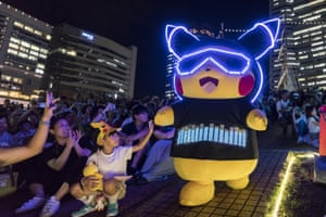 Yokohama, JapanA performer dressed as Pikachu, a character from the Pokémon media franchise marches during the Pikachu Outbreak event.
