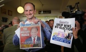 Former Ukip MP Douglas Carswell holds a copy of the local newspaper with the headline The History Maker after winning the Clacton-on-Sea byelection in 2014