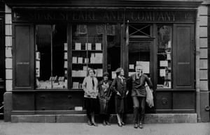 Hemingway (far right) in front of the Shakespeare & Company bookstore in Paris in 1926.