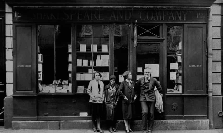 Ernest Hemingway with Sylvia Beach (second right), founder of Shakespeare and Company, outside the shop, Paris, 1926