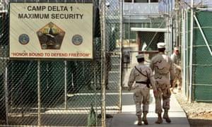 US military guards walk in Camp Delta military-run prison, at the Guantanamo Bay US naval base, Cuba.