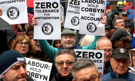 Protestors outside Labour's London HQ hold banners reading 'Zero tolerance for antisemitism' and 'Labour: hold Corbyn to account'