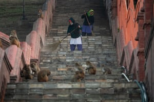 Workers sweep the steps of the Pashupatinath  temple, which has reopened in Kathmandu, Nepal