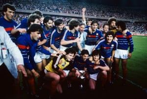 Allez Les Bleus: 27 Jun 1984. The victorious French team pose with the European trophy after beating Spain in the final in Paris. Michel Platini scored his ninth goal of the tournament in the final as France won 2-0.