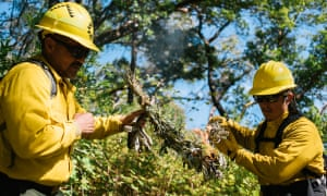 Harold Myers (left) of the Yurok nation and Christopher Villarruel of the Pit River nation start a prescribed burn in the Six Rivers national forest in California.