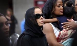 Muhammad Ali's fourth wife Lonnie Ali , stands with Ali's daughter Laila and a grandchild during the service.