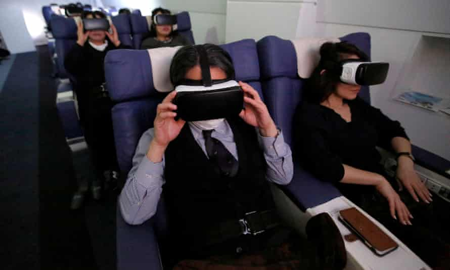Guests wearing VR goggles take a virtual trip with First Airlines in Tokyo.