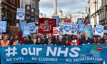 Demonstrators attend a rally in central London, in support of the NHS in 2017.