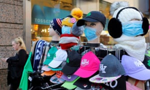 Face masks on display at a souvenir stall in Times Square on 13 March.
