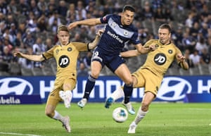 Melbourne Victory's Andrew Nabbout (centre)