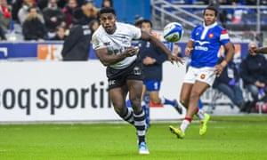 Franck Lomani passes long during Fiji's victory over France.