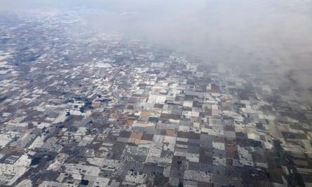Snow-covered farm fields make a quit-like patchwork near Bridgewater, South Dakota.