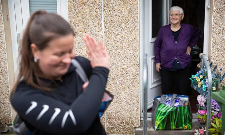 A community worker delivers food parcels to self-isolating elderly people in Glasgow